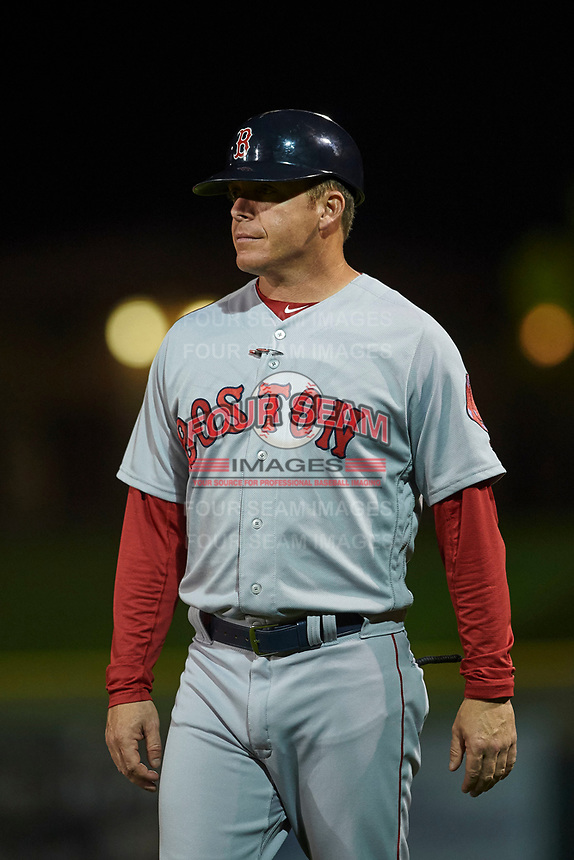 Peoria Javelinas hitting coach Darren Fenster (3), of the Boston Red Sox organization, coaches first base during an Arizona Fall League game against the Scottsdale Scorpions on October 20, 2017 at Scottsdale Stadium in Scottsdale, Arizona. the Javelinas defeated the Scorpions 2-0. (Zachary Lucy/Four Seam Images)