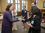 Kate Benson, left, greets Josephine Esteban and DePaul President A. Gabriel Esteban, Ph.D., during a reception Thursday, July 20, 2017, at The Chicago Club. The event was organized to welcome the Estebans to Chicago and introduce them to some of Chicago&rsquo;s most influential women. <br /> (DePaul University/Jamie Moncrief)