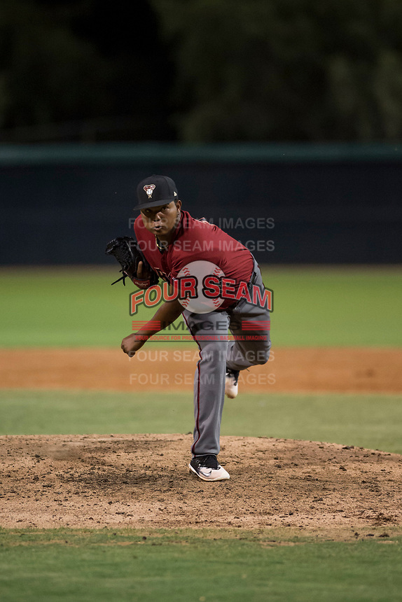 AZL Diamondbacks relief pitcher Ezequiel De La Cruz (14) follows through on his delivery during an Arizona League game against the AZL White Sox at Camelback Ranch on July 12, 2018 in Glendale, Arizona. The AZL Diamondbacks defeated the AZL White Sox 5-1. (Zachary Lucy/Four Seam Images)