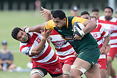 Cameron Skelton swats Salesitongi Savelio out of the way as he makes a strong attacking run. Counties Manukau Premier Counties Power Club Rugby game between Karaka and Pukekohe, played at the Karaka Sports Park on Saturday March 10th 2018. Pukekohe won the game 31 - 27 after trailing 5 - 20 at halftime.<br /> Photo by Richard Spranger.