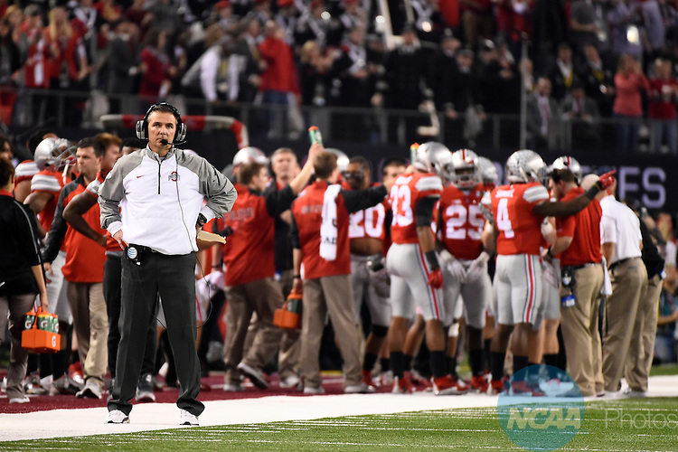 12 JAN 2015:  Head Coach Urban Meyer of Ohio State University awaits the results from a replay against the University of Oregon during the College Football Playoff National Championship held at AT&T Stadium in Arlington, TX.  Ohio State defeated Oregon 42-20 for the national title.  Jamie Schwaberow/NCAA Photos