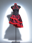 Pretty vintage oriental black and red gothic corset dress on a mannequin in spotlight