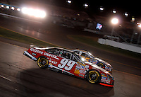 Apr 22, 2006; Phoenix, AZ, USA; Nascar Nextel Cup driver Carl Edwards of the (99) Office Depot Ford Fusion passes Jamie McMurray during the Subway Fresh 500 at Phoenix International Raceway. Mandatory Credit: Mark J. Rebilas-US PRESSWIRE Copyright © 2006 Mark J. Rebilas.