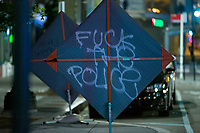 A construction sign is spray painted in Washington, D.C., U.S., on Monday, June 1, 2020, following the death of an unarmed black man at the hands of Minnesota police on May 25, 2020.  More than 200 active duty military police were deployed to Washington D.C. following three days of protests.  Credit: Stefani Reynolds / CNP/AdMedia