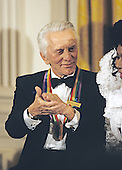 Kirk Douglas, one of the recipients of the 1994 Kennedy Center Honors, appears in the East Room of the White House in Washington, DC at a reception hosted by United States President Bill Clinton and first lady Hillary Rodham Clinton on December 2, 1994.<br /> Credit: Jeffrey Markowitz / Pool via CNP