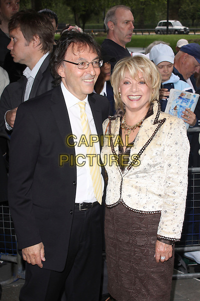 ELAINE PAIGE .Attending the 55th Ivor Novello Awards held at Grosvenor House Hotel in London, England, UK,  May 20th, 2010..arrivals half length smiling make-up gold necklace black cream yellow jacket brown dress .CAP/AH.©Adam Houghton/Capital Pictures.