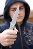Youth with knife UK. Posed by model