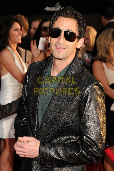 "ADRIEN BRODY .""Iron Man 2"" World Premiere held at the El Capitan Theatre, Hollywood, California , USA, .26th April 2010..arrivals half length sunglasses black aviators leather jacket croc snakeskin snake green shirt .CAP/ADM/BP.©Byron Purvis/AdMedia/Capital Pictures."