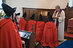 Old Ladies of Castle Rising. The Hospital of the Holy and Undivided Trinity Almshouses, Castle Rising, Norfolk, England 2007. Founders Day. The ladies wear tradiotional red cloaks and pointed black hats. Holy Communion in the chapel.