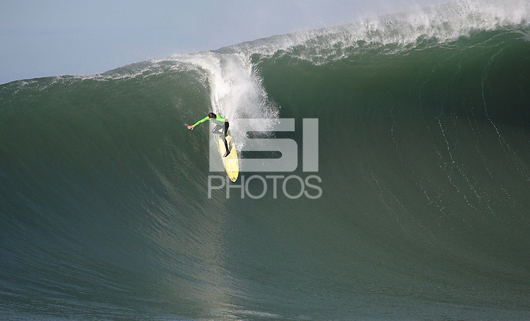 "Grant ""Twiggy"" Baker dropping into a glassy barrel in Heat 4"