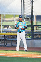 Idaho Falls Chukars bench coach Damon Hollins (27) during a Pioneer League game against the Missoula Osprey at Melaleuca Field on August 20, 2019 in Idaho Falls, Idaho. Idaho Falls defeated Missoula 6-3. (Zachary Lucy/Four Seam Images)
