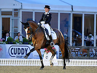16.05.2014.  Windsor Horse Show London Nikki Crisp (GBR) riding Pasoa  during the CD13* FEI Grand Prix Freestyle to music