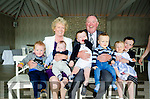 AN O'BRIEN GENERATION CHRISTENING:  Pictured with their six grandchildren are retired Garda Sergeant Mick O'Brien and his wife Rita with their six grandchildren, Hamish Wilson, Michael Anthony Hamilton, Spencer Curtiss, twins Kevin and Hazel O\Brien and Lily Curtiss as they celebrate Michael Anthony's Christening in the Boathouse Restaurant at Dromquinna Manor Kenmare.