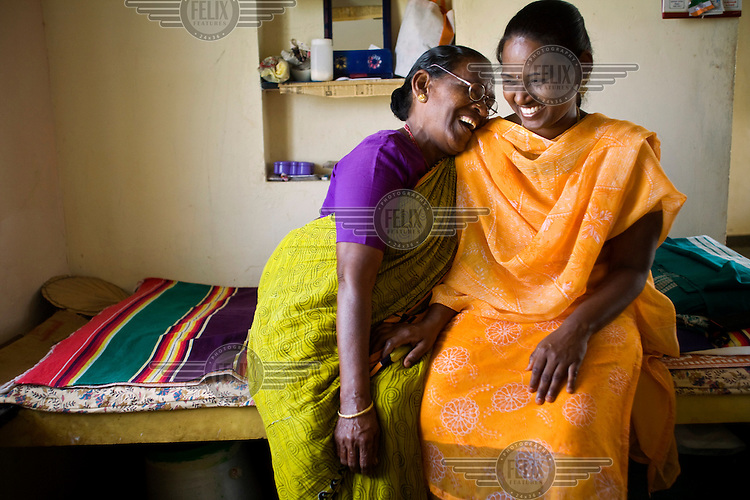 An elderly resident shares a joke with her social worker in her room at the Tamaraikulam Elders' Village. The village is a pioneering experiment initially set up by HelpAge India after the Asian Tsunami to help elderly people displaced by the natural disaster. Today, the village is a self-sustaining community providing a family environment where more able-bodied residents assist the less able-bodied and provides 100 older people with a safe place to live, free healthcare, emotional security, a good diet and professional care and support...