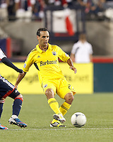 Columbus Crew defender Sebastian Miranda (21) passes the ball. In a Major League Soccer (MLS) match, the New England Revolution tied the Columbus Crew, 0-0, at Gillette Stadium on June 16, 2012.