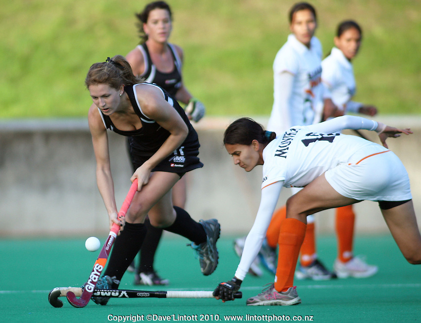 NZ's Stacey Michelsen flicks the ball over Deepika Thakur's tackle during the International hockey match between New Zealand Black Sticks and India fifth test at National Hockey Stadium, Wellington, New Zealand on Sunday, 23 May 2010. Photo: Dave Lintott / lintottphoto.co.nz