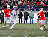 University at Albany Men's Lacrosse defeats Cornell 11-9 on Mar 4 at Casey Stadium.  Connor Fields (#5) shoots and scores the final goal.