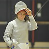 Bridget Becchina of Ward Melville lifts her mask after a sabre victory in the girls fencing Long Island Championship against host Jericho High School on Tuesday, Feb. 6, 2017. She won all three of her bouts to help lead the Patriots to a 14-7 win.
