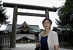 "Yuko Tojo, granddaughter of Japan's wartime leader, General Hideki Tojo, poses outside the main torii gate at Yaskuni Shrine in Tokyo. Gen. Hideki Tojo - who ordered the attack on Pearl Harbor -- was charged and hanged as a war criminal after World War II when Yuko was just 6, and he is enshrined inside the controversial Yasukuni Shrine together with 13 other convicted war criminals. Though she remembers little of her grandfather she still regards him as a hero. ""Japan did not fight a war of aggression but in self-defense,"" says Ms. Tojo, widely seen as a leading figurehead in a recent surge in nationalism in Japan and who unsuccessfully ran for a seat in Japan's House of Councilors in 2007. ""Schoolchildren are told what evil things our country and their ancestors did during the war and this has led to a lack of pride in the Japanese people. This is wrong. We must reinstall a sense of pride and confidence in our children."" Upon running for a seat in Japan's Upper House of Parliament, one of her main goals was to ensure all of Japan's war dead would be enshrined at the central Tokyo shrine."