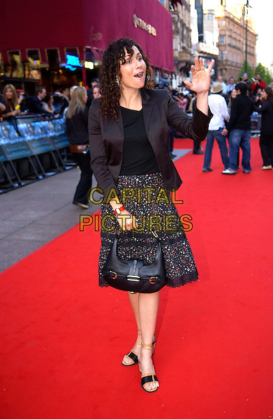 "MINNIE DRIVER.European Film Premiere of ""Kingdom of Heaven"",.Empire Cinema Leicester Square, London, .May 2nd 2005..full length red carpet black jacket skirt jimmy choo bag gold buckles waving funny face .Ref: DH.www.capitalpictures.com.sales@capitalpictures.com.©Capital Pictures."