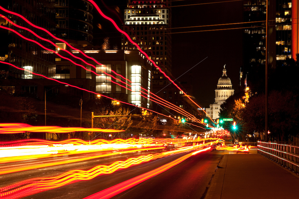 Congress Avenue at Night Showing Car Headlight Trails pointing to the Texas State Capitol.