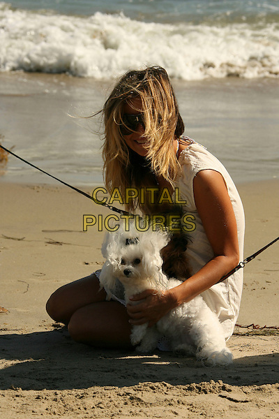 CARMEN ELECTRA & HER DOG.Carmen Electra relaxes and enjoys the surf at the Polaroid Beach House, Malibu, California, USA..August 12th, 2007.full length sunglasses shades white cream dress animal pet.CAP/ADM/RE.©Russ Elliot/AdMedia/Capital Pictures