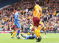 Steven Anderson gets a desperate tackle in on Francis Jeffers