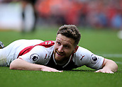 1st October 2017, Emirates Stadium, London, England; EPL Premier League Football, Arsenal versus Brighton; Shkodran Mustafi of Arsenal reacts after sliding into the Brighton box for a loose ball