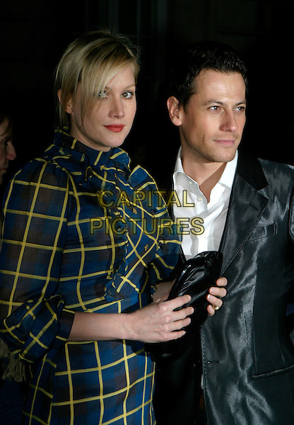 ALICE EVANS & IOAN GRUFFUDD.A Gala Screening of George Michael: A Different Story at Curzon Mayfair Cinema,, London, UK..December 5th, 2005.Ref: AH.half length blue yellow ruffle collar black clutch purse.www.capitalpictures.com.sales@capitalpictures.com.© Capital Pictures.
