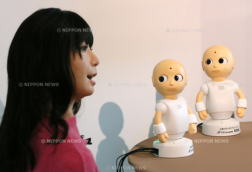 "January 20, 2015, Tokyo, Japan - A symbiotic human-robot Otonaroid, left, and two talking robots ""CommU"" are shown to the media in Tokyo on Tuesday, January 20, 2015.  Eerily lifelike Otonaroid is programmed to speak human language but CommU only talk with its fellow robots. (Photo by Haruyoshi Yamaguchi/AFLO) VTY -mis-"