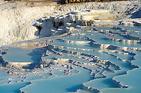 Photo  of Pamukkale Travetine Terrace, Turkey. Images of the white Calcium carbonate rock formations. Buy as stock photos or as photo art prints. 12 Pamukkale travetine terrace water cascades, composed of white Calcium carbonate rock formations, Pamukkale, Anatolia, Turkey