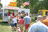 People in line to get food at corn dog and chicken fries concession stand. Aquatennial Beach Bash Minneapolis Minnesota USA