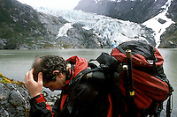 "Dr. Gino Casassa, of the University of Magallanes in Chile, rests his head in his hand at the foot of a glacier named ""Lengua,"" or tongue. Comparing glacial patterns to vegetation changes in the area gives scientists a more complete picture of the region's climate over thousands of years. Researchers<br />