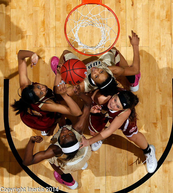 SIOUX FALLS, SD - MARCH 10:  Players from Denver and IUPUI position themselves for the rebound in the second half of their semifinal game at the 2014 Summit League Basketball Championships Monday at the Sioux Falls Arena(Photo by Dave Eggen/Inertia)