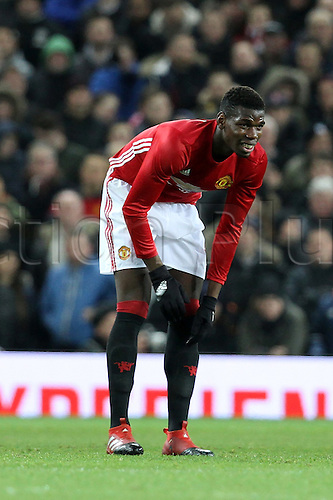 10.01.2017.  Old Trafford, Manchester, Lancashire, England. EFL Cup semi-final 1st leg, Manchester United versus Hull FC. Paul Pogba of Manchester United gets to his feet after being fouled.