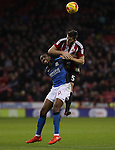 Jonathan Obika of Swindon Town tussles with Jack O'Connell of Sheffield United during the English Football League One match at Bramall Lane, Sheffield. Picture date: December 10th, 2016. Pic Jamie Tyerman/Sportimage
