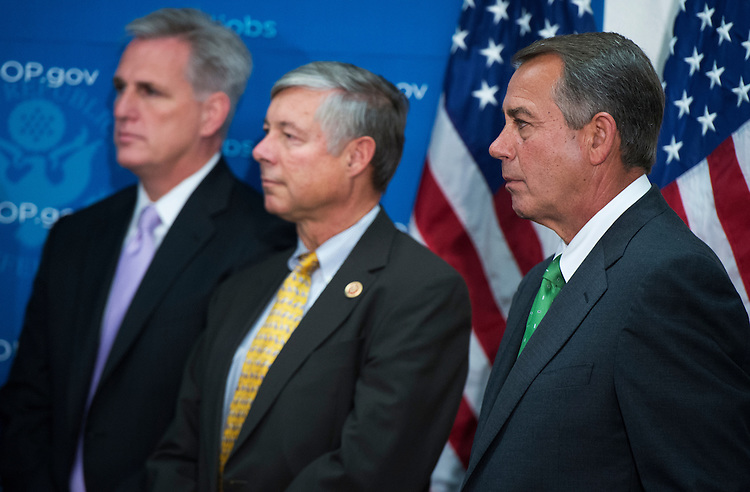 UNITED STATES - SEPTEMBER 26: From left, House Majority Whip Kevin McCarthy, R-Calif., Rep. Fred Upton, R-Mich., and Speaker John Boehner, R-Ohio, conduct a news conference in the Capitol after a meeting of the Republican caucus where they mainly discussed the debt limit debate. (Photo By Tom Williams/CQ Roll Call)