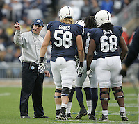 State College, PA - 11/02/2013:  Head coach Bill O'Brien instructs his team captains before the coin toss to start the overtime period.  Penn State defeated Illinois by a score of 24-17 in overtime on Saturday, November 2, 2013, at Beaver Stadium.<br /> <br /> Photos by Joe Rokita / JoeRokita.com