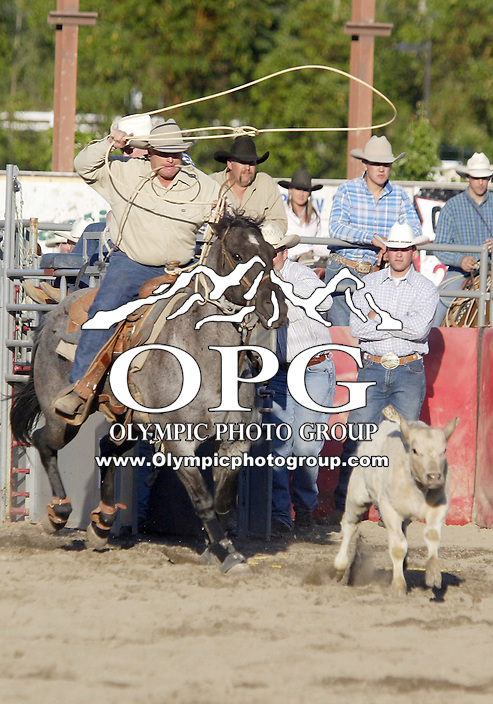Ned Kayser from Centerville, Washington scored a 25.04 in the Calf Roping competition during the Thunderbird Benefit Pro Rodeo in Bremerton, Washington.