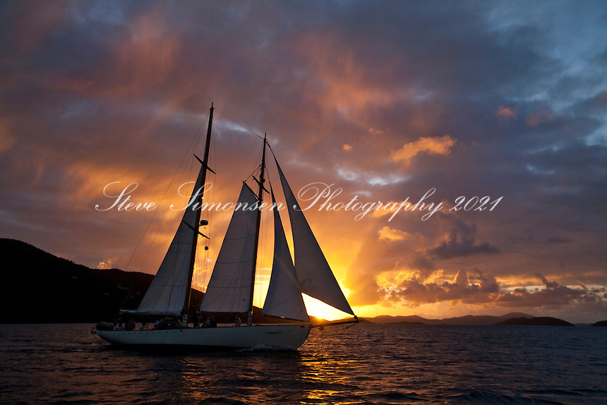 Sailing vessel Heron at sunset from Francis Bay, St. John.U.S. Virgin Islands