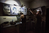 August 2017. Raqqa, Syria.<br /> Members of the MFS cook dinner in their nocter (an abandoned house which is now being used as a base) on the very front lines of western Raqqa. Light and noise discipline is a must due to the threat of ISIS drones and mortars.<br /> The MFS (Syriac Military Council) are a group of Assyrian Christians who fight alongside the Syrian Democratic Forces in the fight to topple ISIS.<br /> Photographer: Rick Findler