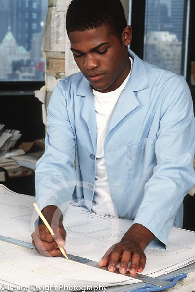 Internship program for college students at major architectural firm, young man at work