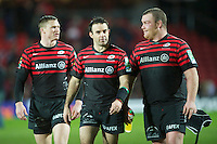 20121216 Copyright onEdition 2012©.Free for editorial use image, please credit: onEdition..Enjoying the moment - (L-R) Chris Ashton, Neil de Kock and Matt Stevens of Saracens after the Heineken Cup Round 4 match between Saracens and Munster Rugby at Vicarage Road on Sunday 16th December 2012 (Photo by Rob Munro)..For press contacts contact: Sam Feasey at brandRapport on M: +44 (0)7717 757114 E: SFeasey@brand-rapport.com..If you require a higher resolution image or you have any other onEdition photographic enquiries, please contact onEdition on 0845 900 2 900 or email info@onEdition.com.This image is copyright onEdition 2012©..This image has been supplied by onEdition and must be credited onEdition. The author is asserting his full Moral rights in relation to the publication of this image. Rights for onward transmission of any image or file is not granted or implied. Changing or deleting Copyright information is illegal as specified in the Copyright, Design and Patents Act 1988. If you are in any way unsure of your right to publish this image please contact onEdition on 0845 900 2 900 or email info@onEdition.com