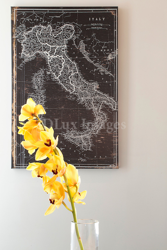 Vintage map of Italy and yellow flowers in glass vase