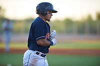 AZL Indians Red Jothson Flores (9) jogs to first base after drawing a walk during an Arizona League game against the AZL Padres 1 on June 23, 2019 at the Cleveland Indians Training Complex in Goodyear, Arizona. AZL Indians Red defeated the AZL Padres 1 3-2. (Zachary Lucy/Four Seam Images)