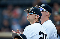 Ben Casstevens (20) of the Wake Forest Demon Deacons watches the action from the dugout during the game against the North Carolina State Wolfpack at David F. Couch Ballpark on April 18, 2019 in  Winston-Salem, North Carolina. The Demon Deacons defeated the Wolfpack 7-3. (Brian Westerholt/Four Seam Images)