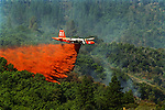 August 24, 1999 Buck Meadows, California -- Pilot Fire – An air tanker battling the Pilot Fire drops retardant along the South Fork of the Tuolumne River canyon six miles west of Yosemite National Park.  The Pilot Fire burned 3,300 acres in the Tuolumne River Canyon near Yosemite National Park. The fire burned across the Hetch Hetchy power lines.