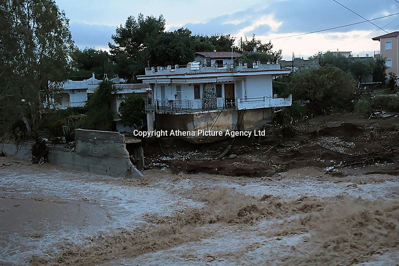 Pictured: A torrent caused by heavy rain, flows next to a property in the area of Kinetta, near Athens, Greece. Monday 25 November<br /> Re: Heavy overnight rainfall has caused flooding and landslides in parts of Greece.