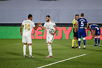 10th July 2020; Estadio Alfredo Di Stefano, Madrid, Spain; La Liga Football, Real Madrid versus Deportivo Alaves; Karim Benzema (Real Madrid)  takes the ball before he scores from the penalty spot in the 11th minute