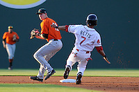 Second basemanTrevor Brown (41) of the Augusta GreenJackets turns a double play as Mookie Betts (7) of the Greenville Drive begins his slide in a game on Thursday, May 9, 2013, at Fluor Field at the West End in Greenville, South Carolina. Augusta won, 6-3. (Tom Priddy/Four Seam Images)